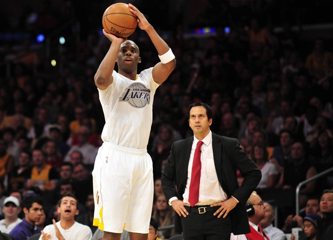 December 25, 2013; Los Angeles, CA, USA; Los Angeles Lakers shooting guard Jodie Meeks (20) attempts a three point basket  as Miami Heat head coach Erik Spoelstra watches during the second half at Staples Center. Mandatory Credit: Gary A. Vasquez-USA TODAY Sports