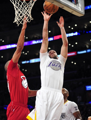 December 25, 2013; Los Angeles, CA, USA; Los Angeles Lakers point guard Jordan Farmar (1) grabs a rebound against the defense of Miami Heat small forward Shane Battier (31) during the second half at Staples Center. Mandatory Credit: Gary A. Vasquez-USA TODAY Sports