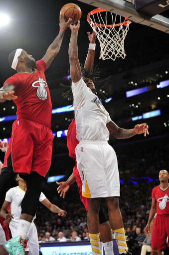 December 25, 2013; Los Angeles, CA, USA; Los Angeles Lakers center Jordan Hill (27) goes for a rebound against Miami Heat small forward LeBron James (6) during the second half at Staples Center. Mandatory Credit: Gary A. Vasquez-USA TODAY Sports