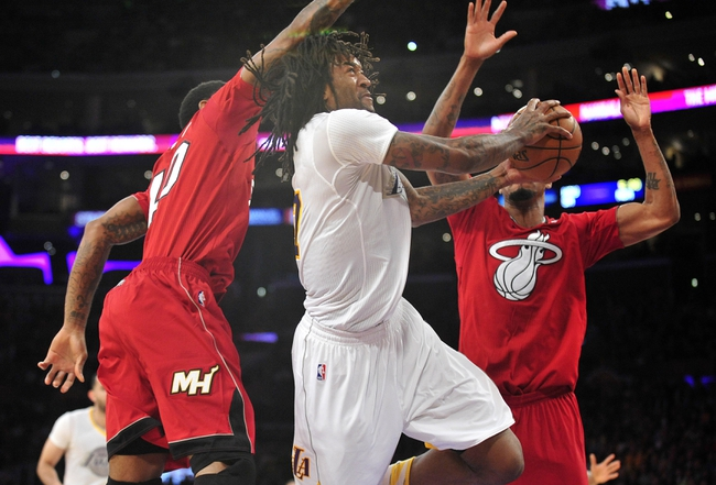 December 25, 2013; Los Angeles, CA, USA; Los Angeles Lakers center Jordan Hill (27) goes in for a basket against the Miami Heat during the second half at Staples Center. Mandatory Credit: Gary A. Vasquez-USA TODAY Sports