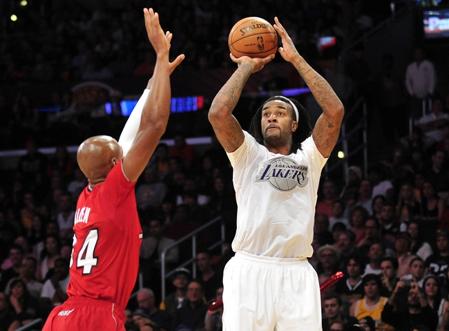 December 25, 2013; Los Angeles, CA, USA; Los Angeles Lakers center Jordan Hill (27) shoots a basket against the defense of Miami Heat shooting guard Ray Allen (34) during the second half at Staples Center. Mandatory Credit: Gary A. Vasquez-USA TODAY Sports