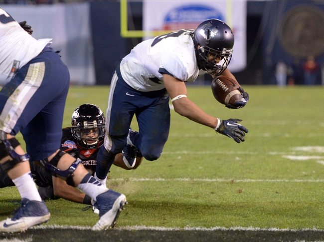 Dec 26, 2013; San Diego, CA, USA; Utah State Aggies running back Joey DeMartino (28) scores on a 1-yard touchdown run in the fourth quarter against the Northern Illinois Huskies in the 2013 Poinsettia Bowl at Qualcomm Stadium. Mandatory Credit: Kirby Lee-USA TODAY Sports
