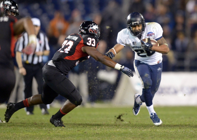 Dec 26, 2013; San Diego, CA, USA; Utah State Aggies running back Joey DeMartino (28) is pursued by Northern Illinois Huskies linebacker Jamaal Payton (33) in the fourth quarter during the 2013 Poinsettia Bowl at Qualcomm Stadium. Mandatory Credit: Kirby Lee-USA TODAY Sports