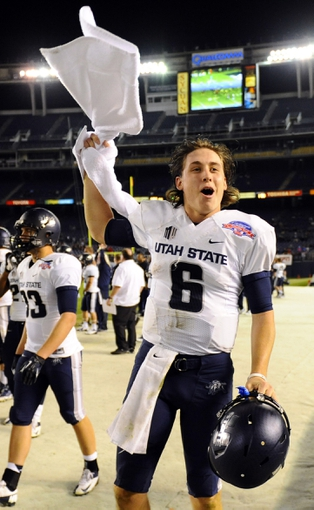 Dec 26, 2013; San Diego, CA, USA; Utah State Aggies quarterback Darell Garretson (6) celebrates on the sidelines in the fourth quarter against the Northern Illinois Huskies during the 2013 Poinsettia Bowl at Qualcomm Stadium. The Aggies won 21-14. Mandatory Credit: Christopher Hanewinckel-USA TODAY Sports