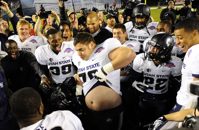 Dec 26, 2013; San Diego, CA, USA; Utah State Aggies offensive lineman Travis Seefeldt (70) celebrates with teammates after a win against the Northern Illinois Huskies during the 2013 Poinsettia Bowl at Qualcomm Stadium. The Aggies won 21-14. Mandatory Credit: Christopher Hanewinckel-USA TODAY Sports