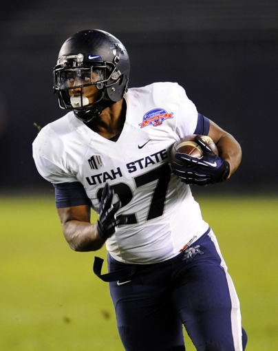 Dec 26, 2013; San Diego, CA, USA; Utah State Aggies running back Robert Marshall (27) runs for a first down in the second half against the Northern Illinois Huskies during the 2013 Poinsettia Bowl at Qualcomm Stadium. Mandatory Credit: Christopher Hanewinckel-USA TODAY Sports