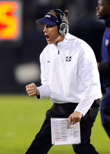 Dec 26, 2013; San Diego, CA, USA; Utah State Aggies head coach Matt Wells celebrates after a defensive stop in the second half against the Northern Illinois Huskies during the 2013 Poinsettia Bowl at Qualcomm Stadium. Mandatory Credit: Christopher Hanewinckel-USA TODAY Sports