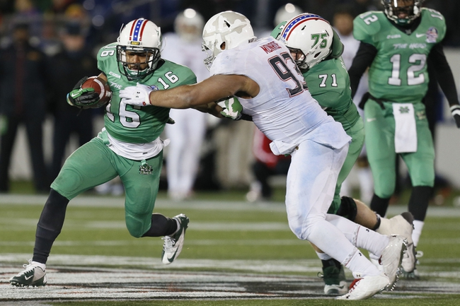 Dec 27, 2013; Annapolis, MD, USA; Marshall Thundering Herd running back Essray Taliaferro (16) runs past Maryland Terrapins lineman Andre Monroe (93) during the 2013 Military Bowl at Navy-Marine Corps Memorial Stadium. Mandatory Credit: Mitch Stringer-USA TODAY Sports