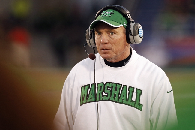 Dec 27, 2013; Annapolis, MD, USA; Marshall Thundering Herd head coach Doc Holliday walks on the sidelines in the second half against the Maryland Terrapins during the 2013 Military Bowl at Navy Marine Corps Memorial Stadium. Mandatory Credit: Geoff Burke-USA TODAY Sports