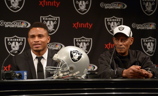 Dec 27, 2013; Alameda, CA, USA; Nnamdi Asomugha (left) and Willie Brown at press conference at Oakland Raiders Practice Facility. Mandatory Credit: Kirby Lee-USA TODAY Sports