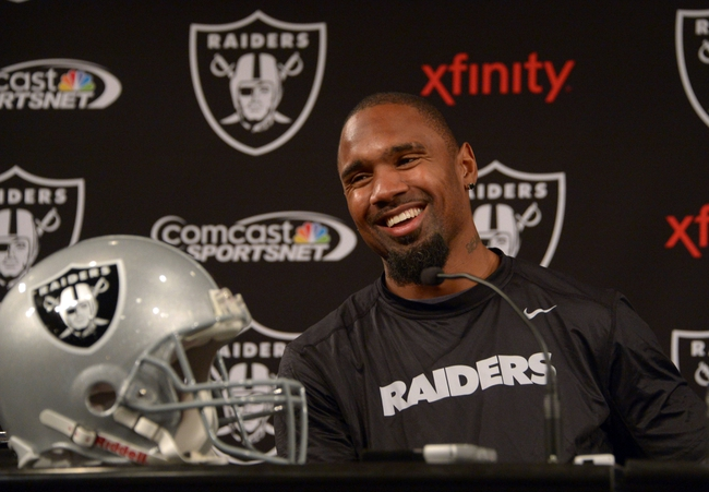Dec 27, 2013; Alameda, CA, USA; Oakland Raiders safety Charles Woodson at press conference at Oakland Raiders Practice Facility.