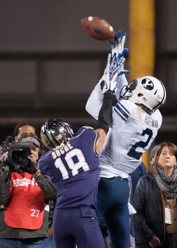 Dec 27, 2013; San Francisco, CA, USA; Brigham Young Cougars wide receiver Cody Hoffman (2) attempts to catch a pass against Washington Huskies defensive back Gregory Ducre (18) during the second quarter at AT&T Park. Mandatory Credit: Ed Szczepanski-USA TODAY Sports
