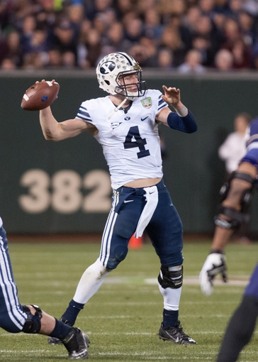 Dec 27, 2013; San Francisco, CA, USA; Brigham Young Cougars quarterback Taysom Hill (4) throws a pass against the Washington Huskies during the second quarter at AT&T Park. Mandatory Credit: Ed Szczepanski-USA TODAY Sports