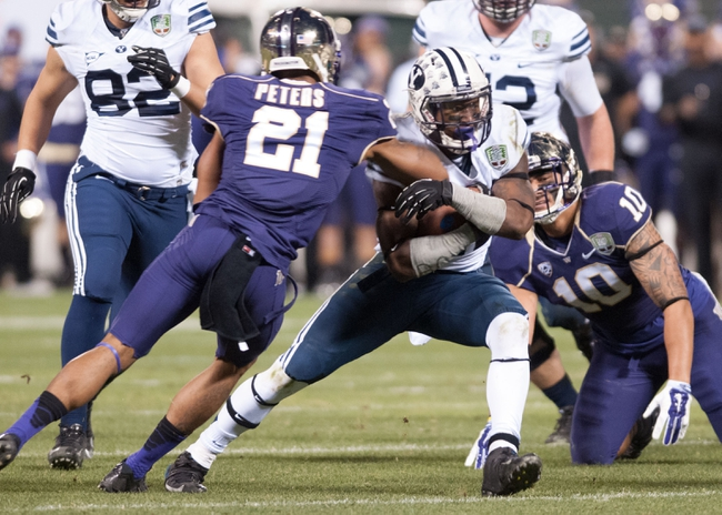 Dec 27, 2013; San Francisco, CA, USA; Brigham Young Cougars running back Jamaal Williams (21) is tackled by Washington Huskies defensive back Marcus Peters (21) during the second quarter at AT&T Park. Mandatory Credit: Ed Szczepanski-USA TODAY Sports