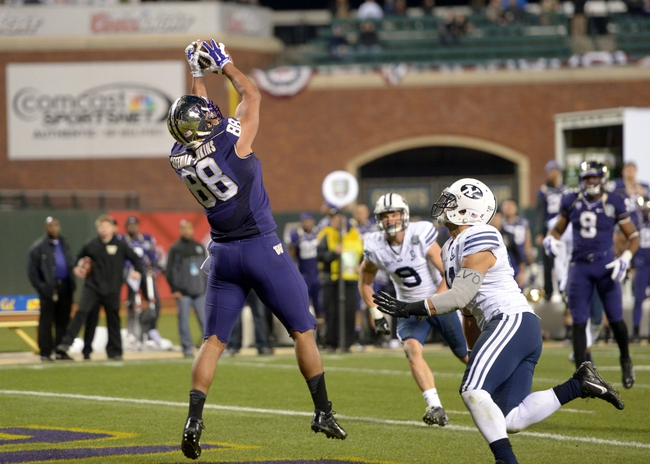 Dec 27, 2013; San Francisco, CA, USA; Washington Huskies tight end Austin Seferian-Jenkins (88) is defended by BYU Cougars linebacker Uani 'Unga (41) on a 16-yard touchdown reception in the third quarter in the 2013 Fight Hunger Bowl at AT&T Park. Mandatory Credit: Kirby Lee-USA TODAY Sports