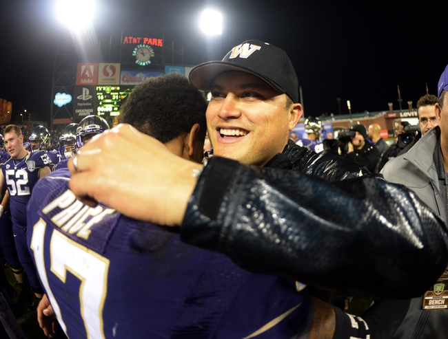 Dec 27, 2013; San Francisco, CA, USA; Washington Huskies interim coach Marques Tuiasosopo (right) embraces quarterback Keith Price (17) after the 2013 Fight Hunger Bowl against the BYU Cougars at AT&T Park. Washington defeated BYU 31-16. Mandatory Credit: Kirby Lee-USA TODAY Sports