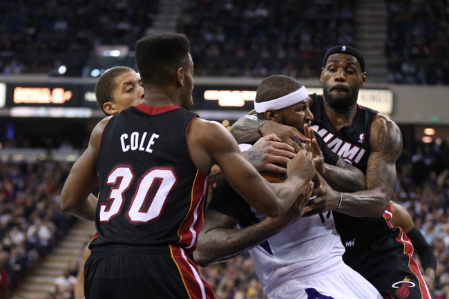 Dec 27, 2013; Sacramento, CA, USA; Miami Heat small forward LeBron James (6) fouls Sacramento Kings center DeMarcus Cousins (15) during the fourth quarter at Sleep Train Arena. The Sacramento Kings defeated the Miami Heat 108-103 in overtime. Mandatory Credit: Kelley L Cox-USA TODAY Sports