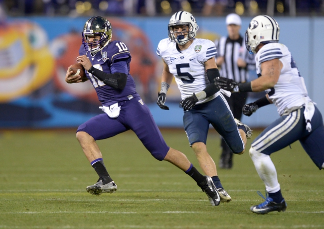 Dec 27, 2013; San Francisco, CA, USA; Washington Huskies quarterback Cyler Miles (10) scrambles fromo BYU Cougars linebackers Alani Fua (5) and Tyler Beck (45) in the 2013 Fight Hunger Bowl at AT&T Park. Washington defeated BYU 31-16. Mandatory Credit: Kirby Lee-USA TODAY Sports