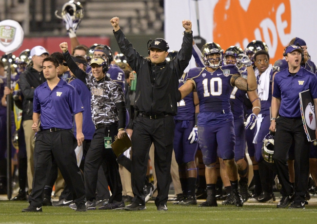 Dec 27, 2013; San Francisco, CA, USA; Washington Huskies interim coach Marques Tuiasosopo celebrates during the 2013 Fight Hunger Bowl against the BYU Cougars at AT&T Park. Washington defeated BYU 31-16. Mandatory Credit: Kirby Lee-USA TODAY Sports