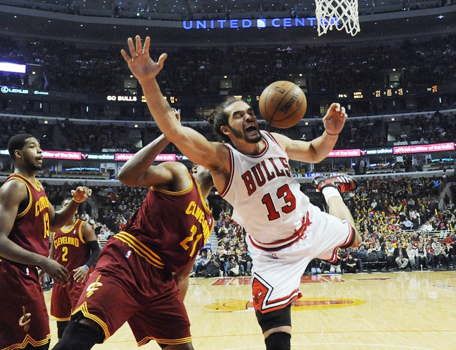 Dec 21, 2013; Chicago, IL, USA; Chicago Bulls center Joakim Noah (13) is fouled by Cleveland Cavaliers center Andrew Bynum (21) during the second half at the United Center. T'he Chicago Bulls defeated the Cleveland Cavaliers 100-84. Mandatory Credit: David Banks-USA TODAY Sports