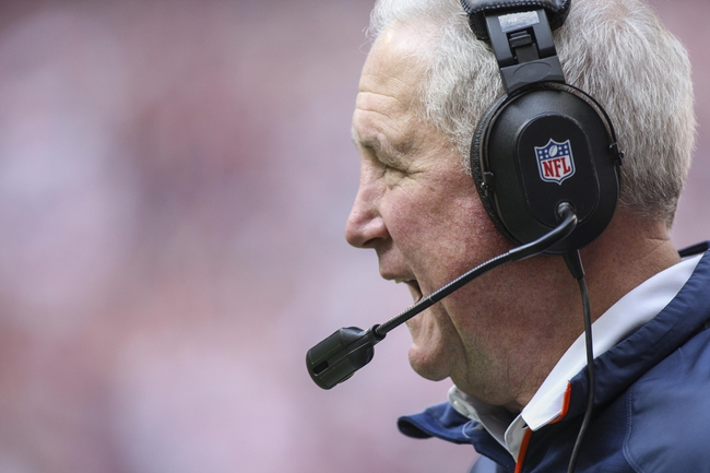 Dec 22, 2013; Houston, TX, USA; Denver Broncos head coach John Fox shouts from the sideline during the third quarter against the Houston Texans at Reliant Stadium. Mandatory Credit: Troy Taormina-USA TODAY Sports