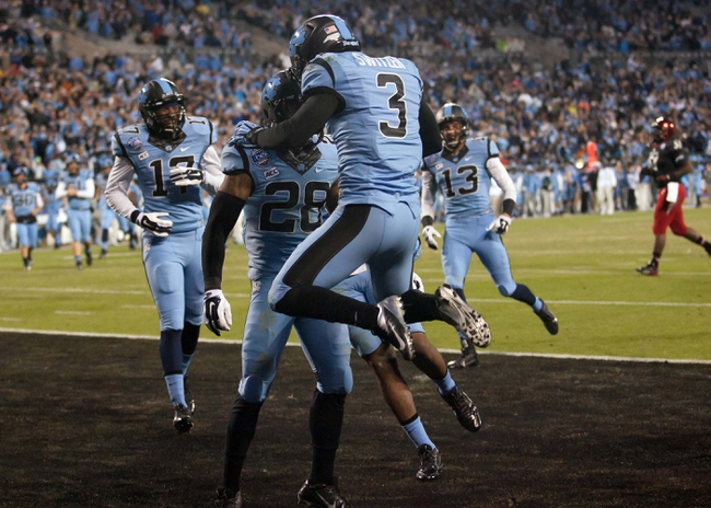 Dec 28, 2013; Charlotte, NC, USA; North Carolina Tar Heels wide receiver Ryan Switzer (3) celebrates after scoring a touchdown during the third quarter against the Cincinnati Bearcats in the Belk Bowl at Bank of America Stadium. Carolina defeated Cincinnati 39-17. Mandatory Credit: Jeremy Brevard-USA TODAY Sports