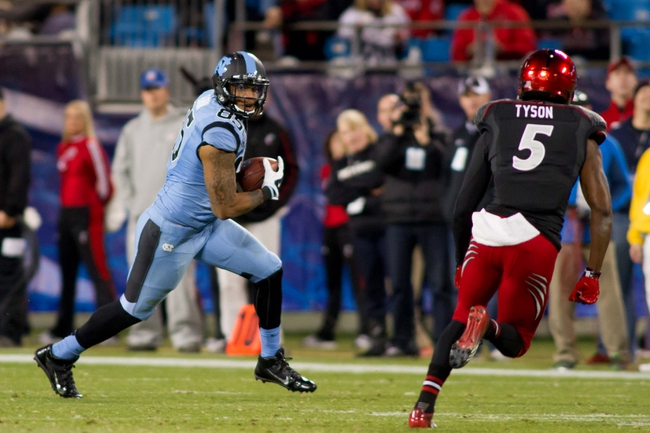 Dec 28, 2013; Charlotte, NC, USA; North Carolina Tar Heels tight end Eric Ebron (85) runs after making a catch during the third quarter in the Belk Bowl at Bank of America Stadium. Carolina defeated Cincinnati 39-17. Mandatory Credit: Jeremy Brevard-USA TODAY Sports