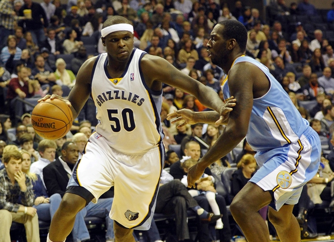 Dec 28, 2013; Memphis, TN, USA; Memphis Grizzlies power forward Zach Randolph (50) drives to the basket against Denver Nuggets power forward J.J. Hickson (7) during the second quarter at FedExForum. Mandatory Credit: Justin Ford-USA TODAY Sports