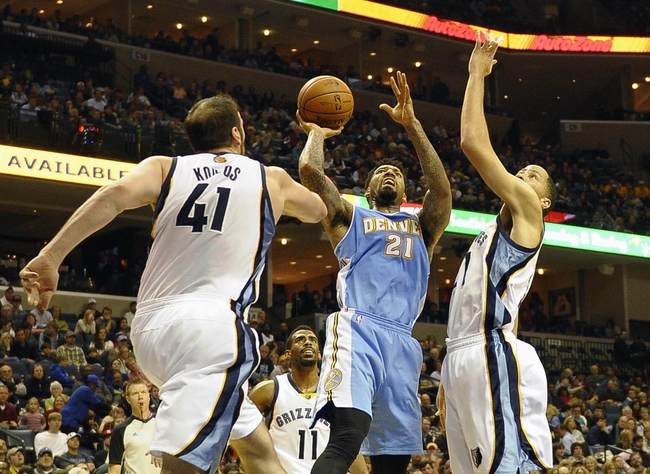 Dec 28, 2013; Memphis, TN, USA; Denver Nuggets small forward Wilson Chandler (21) lays the ball up against Memphis Grizzlies center Kosta Koufos (41) and Memphis Grizzlies small forward Tayshaun Prince (21) during the third quarter at FedExForum. Mandatory Credit: Justin Ford-USA TODAY Sports