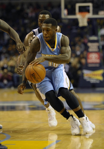 Dec 28, 2013; Memphis, TN, USA; Denver Nuggets point guard Nate Robinson (10) handles the ball against Memphis Grizzlies shooting guard Tony Allen (9) during the third quarter at FedExForum. Mandatory Credit: Justin Ford-USA TODAY Sports