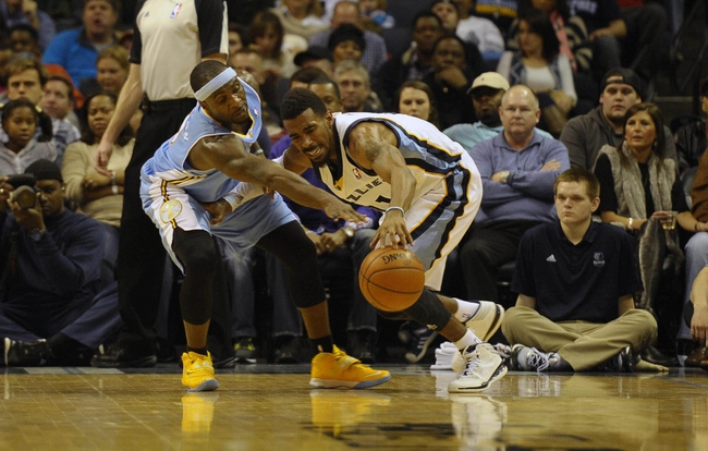 Dec 28, 2013; Memphis, TN, USA; Memphis Grizzlies point guard Mike Conley (11) and Denver Nuggets point guard Ty Lawson (3) fight for the ball during the third quarter at FedExForum. Mandatory Credit: Justin Ford-USA TODAY Sports