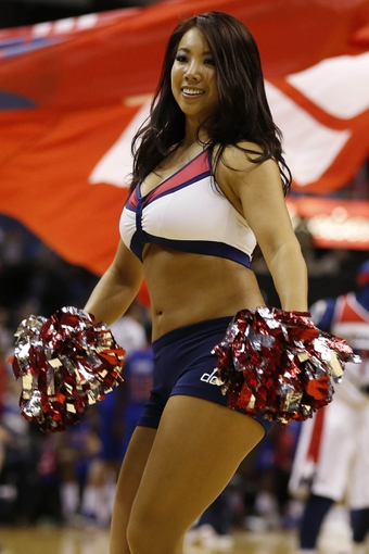 Dec 28, 2013; Washington, DC, USA; A Washington Wizards Girl dances on the court against the Detroit Pistons at Verizon Center. The Wizards won 106-82. Mandatory Credit: Geoff Burke-USA TODAY Sports