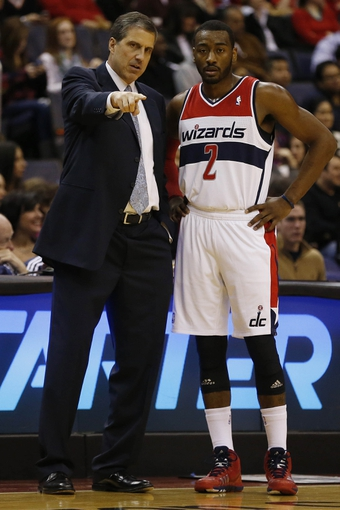 Dec 28, 2013; Washington, DC, USA; Washington Wizards head coach Randy Wittman talks with Wizards point guard John Wall (2) against the Detroit Pistons in the second quarter at Verizon Center. The Wizards won 106-82. Mandatory Credit: Geoff Burke-USA TODAY Sports