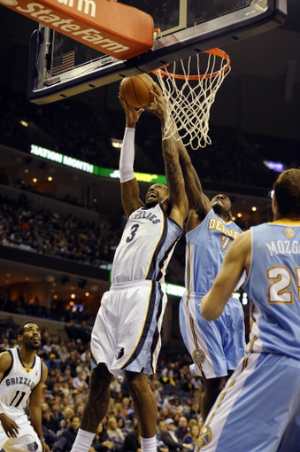 Dec 28, 2013; Memphis, TN, USA; Memphis Grizzlies power forward James Johnson (3) grabs a rebound against Denver Nuggets power forward J.J. Hickson (7) during the fourth quarter at FedExForum. Mandatory Credit: Justin Ford-USA TODAY Sports