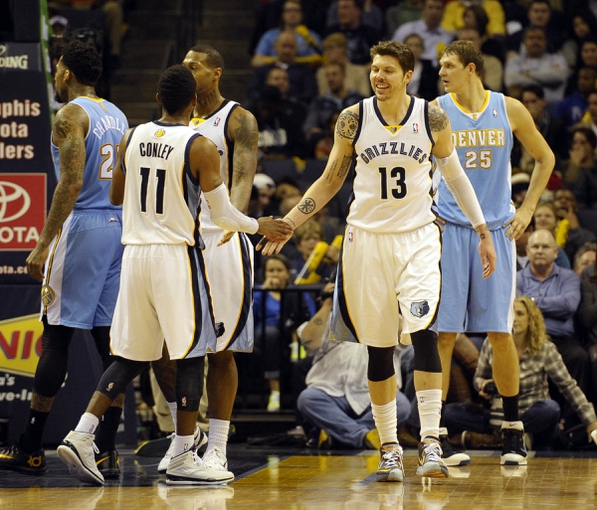 Dec 28, 2013; Memphis, TN, USA; Memphis Grizzlies point guard Mike Conley (11) and Memphis Grizzlies small forward Mike Miller (13) celebrate against the Denver Nuggets during the fourth quarter at FedExForum. Mandatory Credit: Justin Ford-USA TODAY Sports