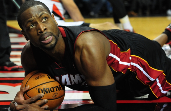 Dec 28, 2013; Portland, OR, USA; Miami Heat shooting guard Dwyane Wade (3) looks up for a call from the official during the first quarter of the game against the Portland Trail Blazers at the Moda Center. Mandatory Credit: Steve Dykes-USA TODAY Sports
