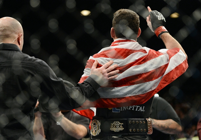 Dec 28, 2013; Las Vegas, NV, USA;    Chris Weidman reacts in the cage after defeating Anderson Silva (not pictured) in their UFC middleweight championship bout at the MGM Grand Garden Arena. Mandatory Credit: Jayne Kamin-Oncea-USA TODAY Sports