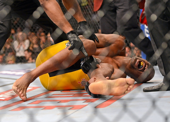 Dec 28, 2013; Las Vegas, NV, USA;    Anderson Silva reacts after breaking his leg on a kick to Chris Weidman (not pictured) during their UFC middleweight championship b