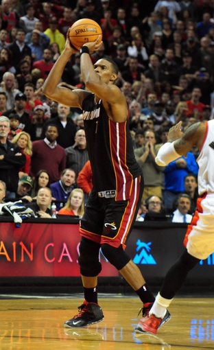 Dec 28, 2013; Portland, OR, USA; Miami Heat center Chris Bosh (1) hits the game winning shot during the fourth quarter of the game against the Portland Trail Blazers at the Moda Center. The Heat won the game 108-107. Mandatory Credit: Steve Dykes-USA TODAY Sports