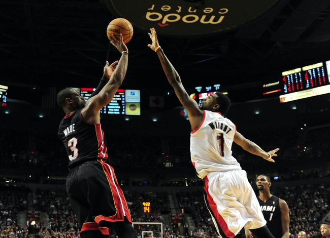 Dec 28, 2013; Portland, OR, USA; Miami Heat shooting guard Dwyane Wade (3) puts up a shot on Portland Trail Blazers small forward Dorell Wright (1) during the fourth quarter of the game at the Moda Center. The Heat won the game 108-107. Mandatory Credit: Steve Dykes-USA TODAY Sports