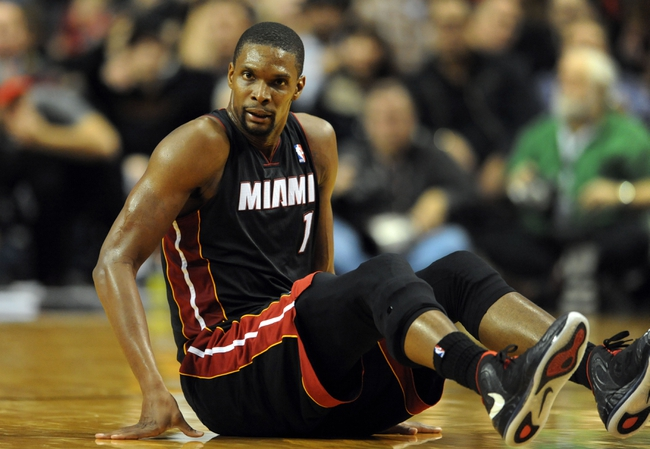 Dec 28, 2013; Portland, OR, USA; Miami Heat center Chris Bosh (1) picks himself up off the court during the fourth quarter of the game against the Portland Trail Blazers at the Moda Center. The Heat won the game 108-107. Mandatory Credit: Steve Dykes-USA TODAY Sports