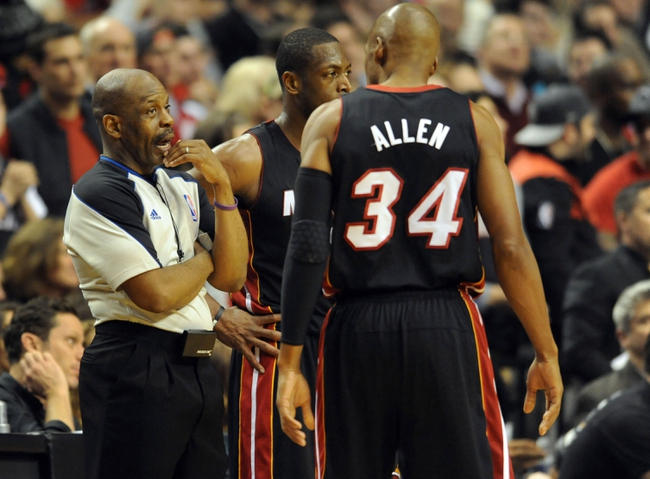 Dec 28, 2013; Portland, OR, USA; Miami Heat shooting guard Ray Allen (34) speaks with referee Derek Richardson (63) during the fourth quarter of the game at the Moda Center. The Heat won the game 108-107. Mandatory Credit: Steve Dykes-USA TODAY Sports