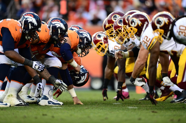 Oct 27, 2013; Denver, CO, USA; Members of the Washington Redskins and the Denver Broncos line up across from each other in the fourth quarter at Sports Authority Field at Mile High. Mandatory Credit: Ron Chenoy-USA TODAY Sports