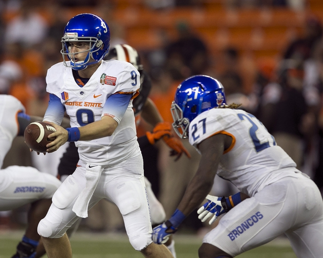 Dec 24, 2013; Honolulu, HI, USA; Boise State Broncos quarterback Nick Patti (8) makes a hand off to Boise State Broncos running back Jay Ajayi (27) during the 2013 Hawaii Bowl against the Oregon State Beavers at Aloha Stadium. Mandatory Credit: Marco Garcia-USA TODAY Sports