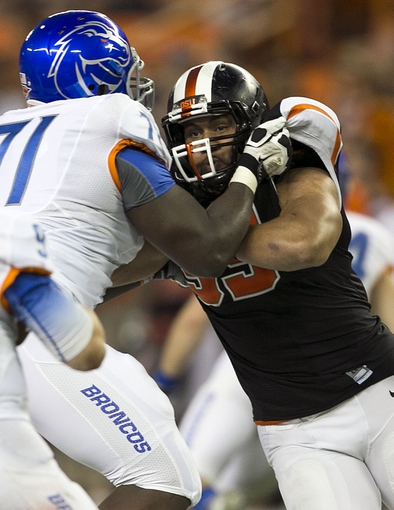 Dec 24, 2013; Honolulu, HI, USA; Oregon State Beavers defensive end Scott Crichton (95) is blocked by Boise State Broncos offensive linesman Rees Odhiambo (71) during the fourth quarter at the 2013 Hawaii Bowl at Aloha Stadium. Mandatory Credit: Marco Garcia-USA TODAY Sports