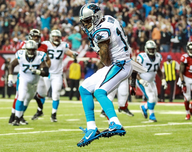 Dec 29, 2013; Atlanta, GA, USA; Carolina Panthers wide receiver Ted Ginn (19) catches a touchdown pass in the first half against the Atlanta Falcons at the Georgia Dome. Mandatory Credit: Daniel Shirey-USA TODAY Sports