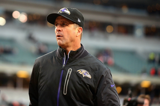 Dec 29, 2013; Cincinnati, OH, USA; Baltimore Ravens head coach John Harbaugh walks off the field after being defeated by Cincinnati Bengals 34-17 at Paul Brown Stadium. Mandatory Credit: Andrew Weber-USA TODAY Sports