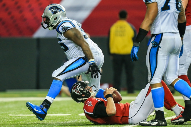 Dec 29, 2013; Atlanta, GA, USA; Carolina Panthers defensive end Charles Johnson (95) celebrates after sacking Atlanta Falcons quarterback Matt Ryan (2) in the second half at the Georgia Dome. The Panthers won 21-20. Mandatory Credit: Daniel Shirey-USA TODAY Sports