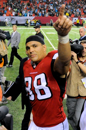 Dec 29, 2013; Atlanta, GA, USA; Atlanta Falcons tight end Tony Gonzalez (88) points to the fans after the game against the Carolina Panthers at the Georgia Dome. The Panthers won 21-20. Mandatory Credit: Dale Zanine-USA TODAY Sports