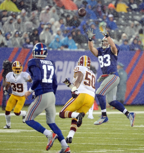 Dec 29, 2013; East Rutherford, NJ, USA; New York Giants tight end Brandon Myers (83) makes a catch against the Washington Redskins during the game at MetLife Stadium. Mandatory Credit: Robert Deutsch-USA TODAY Sports